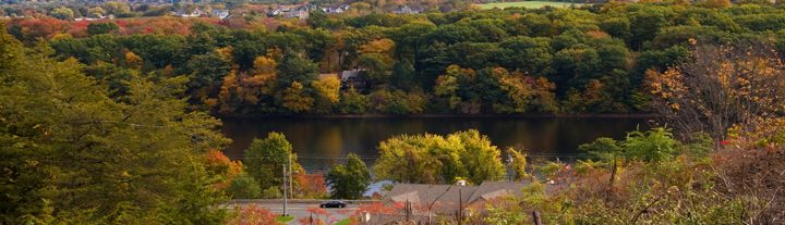 New England scenery overlooking Ludlow Mass with colorful fall foliage.
